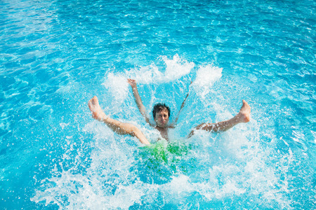 Man falling and splashing into water Stock Photo