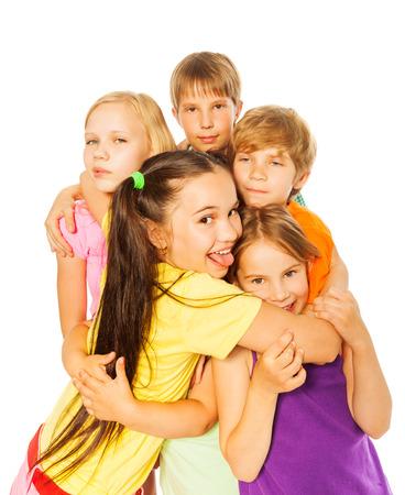 kids hugging: Five smiling hugging kids
