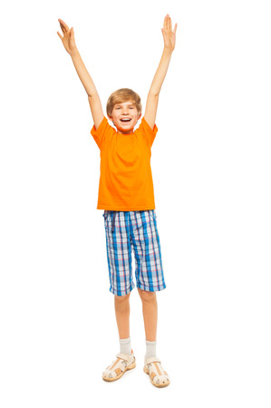 front raise: Young boy raises hands up Stock Photo
