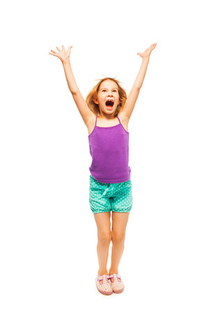 Little girl shouts raising up her hands photo