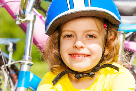 Young little girl and bikes photo