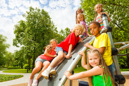 Group of kids on playground construction together photo
