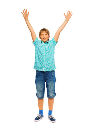 front raise: Cute young boy on a white background Stock Photo