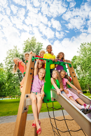 play the old park: Group of friends together on a chute in summer
