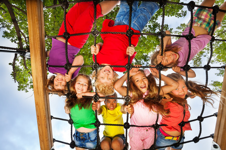 Many kids look though gridlines of playground photo