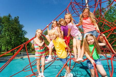 fair haired: Group of kids sitting together on red ropes