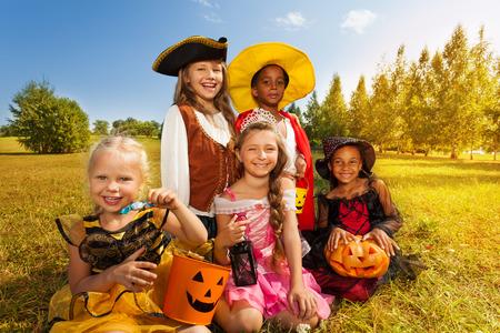Multinational children in Halloween costumes