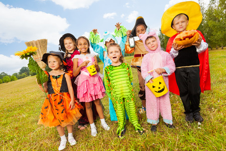 Children in different Halloween costumes standing photo