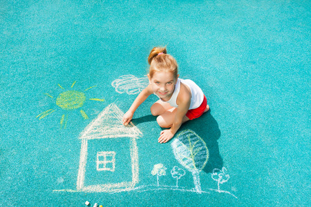 Nice Caucasian little girl draw chalk house image photo