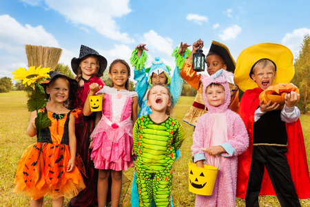 Happy excited kids in Halloween costumes Stock Photo