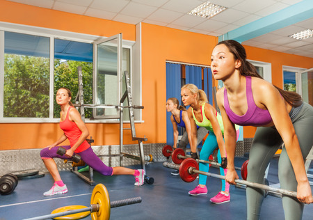 sports bar: Group weight lifting class in fitness club