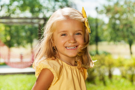 Portrait of smiling happy blond little girl  Stock Photo