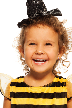 Portrait of laughing girl in striped bee costume photo