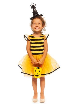 Little girl with candy bucket on Halloween  photo