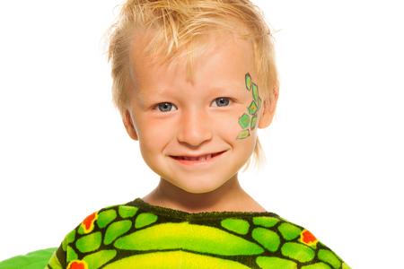 squama: Close portrait of little boy in dragon costume