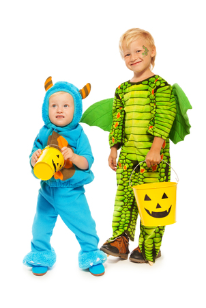 squama: Two brothers in monster costumes on Halloween
