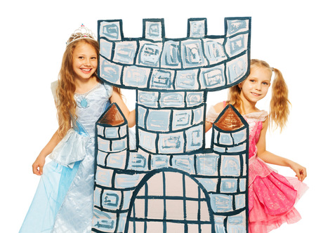Two princesses behind cardboard castle tower photo