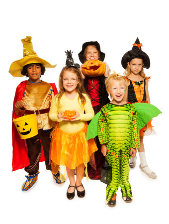 Kids with pumpkin and in Halloween costumes photo