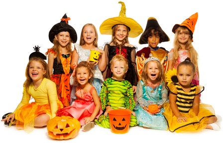 Ten kids in Halloween costumes together isolated photo