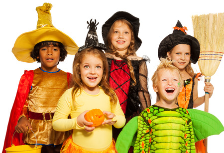 Close shoot of five kids in Halloween costumes Stock Photo