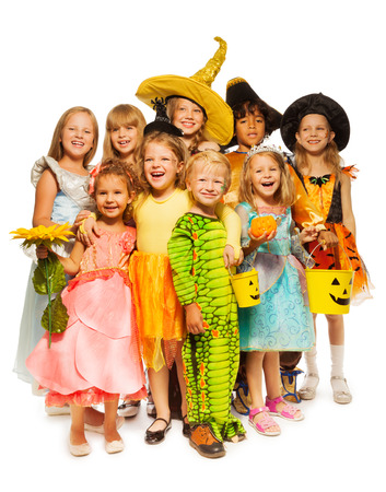stage costume: Many kids stand in Halloween costumes together Stock Photo