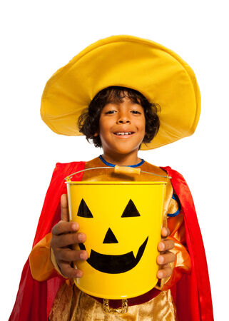 Boy in costume with Halloween spooky candy bucket photo