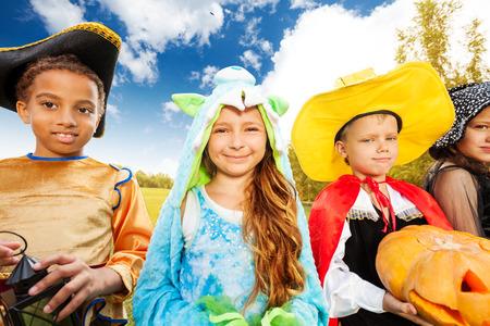 Kids wear Halloween costume outside in park Stock Photo