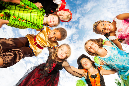 Many kids, Halloween costumes look down in circle Stok Fotoğraf