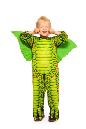 full height: Blond boy in dragon costume full height portrait Stock Photo