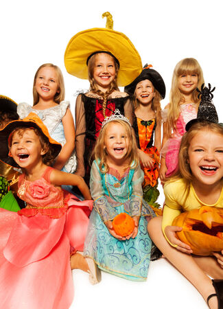 Funny happy kids in Halloween costumes