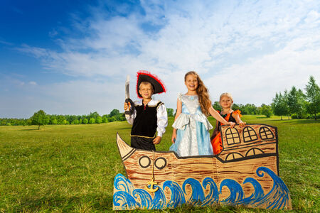 pirate girl: Pirate with sword and two princesses stand on ship Stock Photo