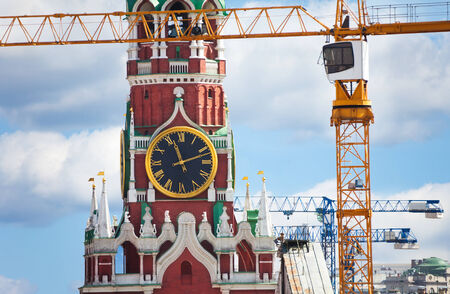 spassky: Kremlin clock up view with construction cranes