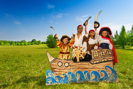 multinational: Happy diversity children as pirates with swords Stock Photo