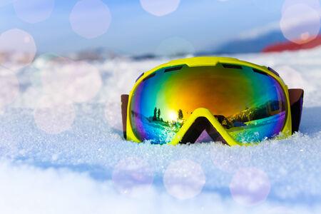 ski goggles: View of yellow ski mask on white icy snow