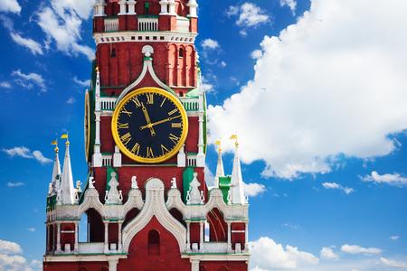 spassky: Kremlin Spasskaya tower clock over sky with clouds Stock Photo