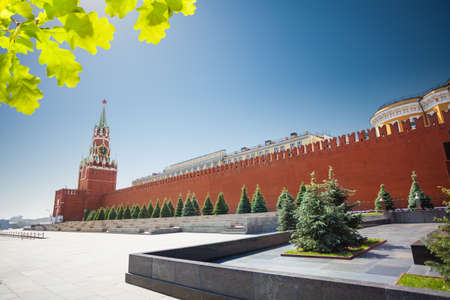 spasskaya: Long Kremlin wall view with Spasskaya tower Stock Photo