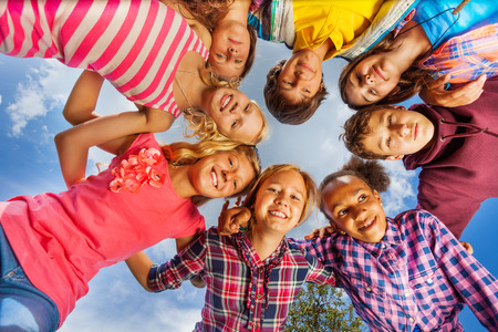 multinational: Bottom view of kids group standing in round shape Stock Photo