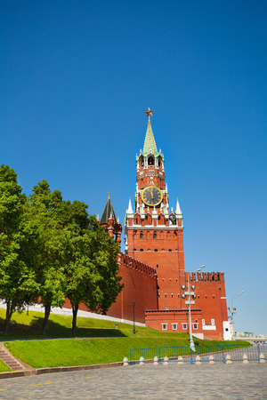 spassky: Spasskaya tower with clock with Kremlin wall during day in summer in Moscow, Russia