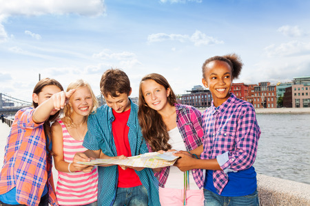 multinational: Happy children with map standing together Stock Photo