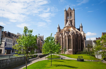 flemish region: View of St Nicholas Church in beautiful Ghent downtown with spring park in Flemish region, Belgium