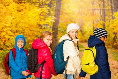 rucksacks: Back view of happy children wearing rucksacks Stock Photo