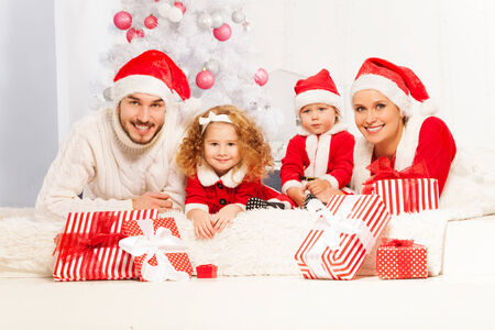 Happy family with presents on New Year eve photo