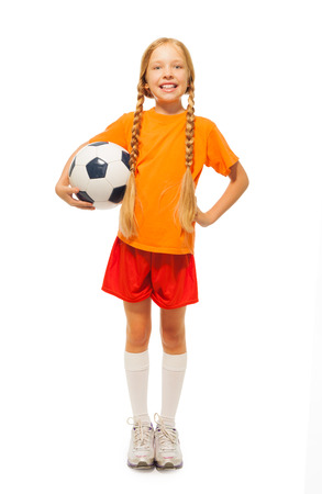 kids soccer: Little blond girl holding soccer ball isolated Stock Photo