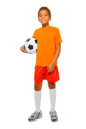 Little African boy holding soccer ball isolated Stock Photo
