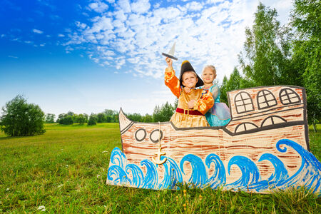 fairy tale princess: Boy as pirate and princess girl stand on ship
