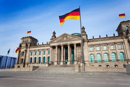 german culture: Reichstag facade view with German flags, Berlin