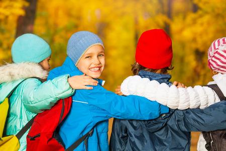 rucksacks: Back view of happy children with rucksacks