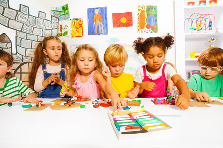 clay modeling: Large group of kids play with modeling clay
