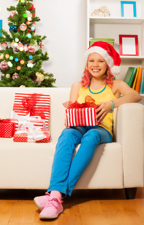 Happy blond smiling girl with presents photo