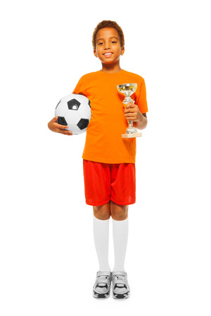 boy ball: Little African boy holding soccer ball and prize
